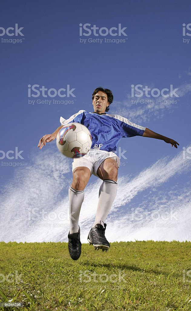 Soccer player hitting the ball royalty-free stock photo