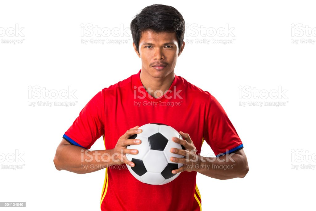 Soccer player hold a football on white backgroud with clipping path. stock photo