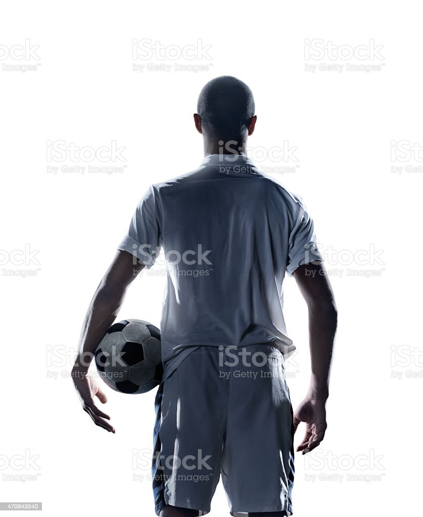 Soccer player holding a ball stock photo