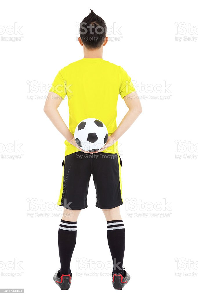 soccer player holding a soccer stock photo