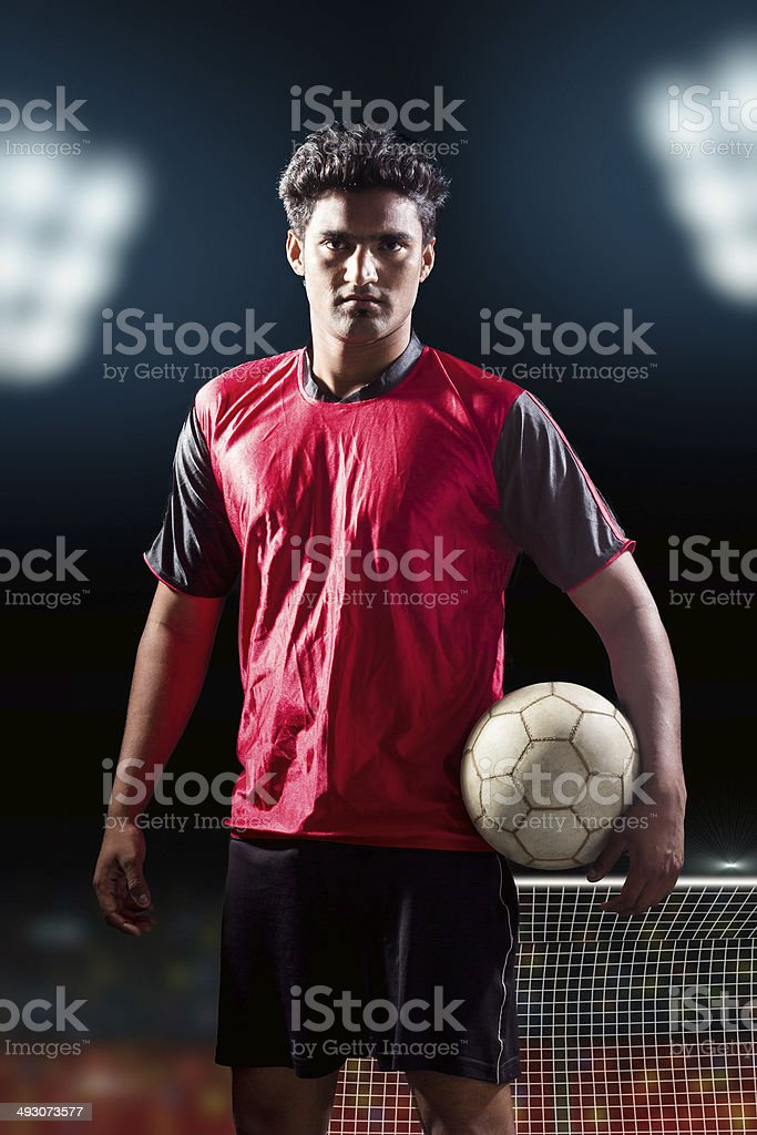 Soccer player holding ball royalty-free stock photo