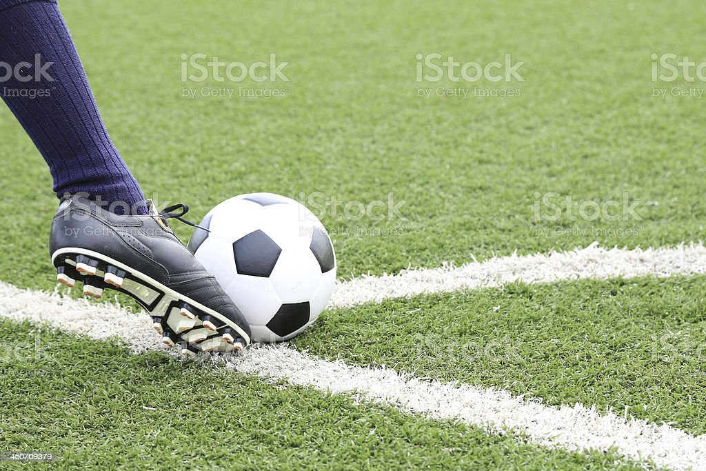 Soccer player in a motion to kick a soccer ball royalty-free stock photo