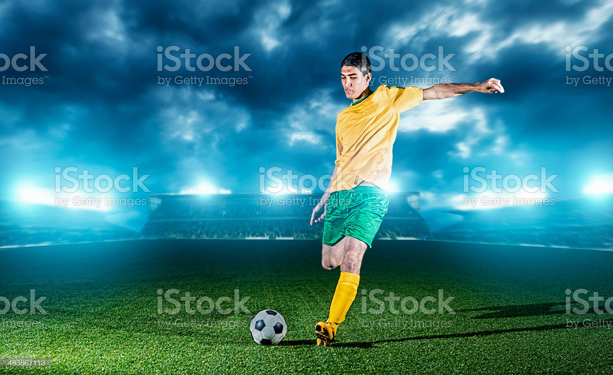 Soccer player in a stadium kicks football royalty-free stock photo