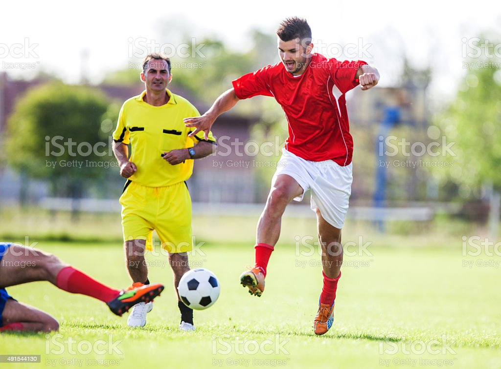 Soccer player in action on a playing field. stock photo