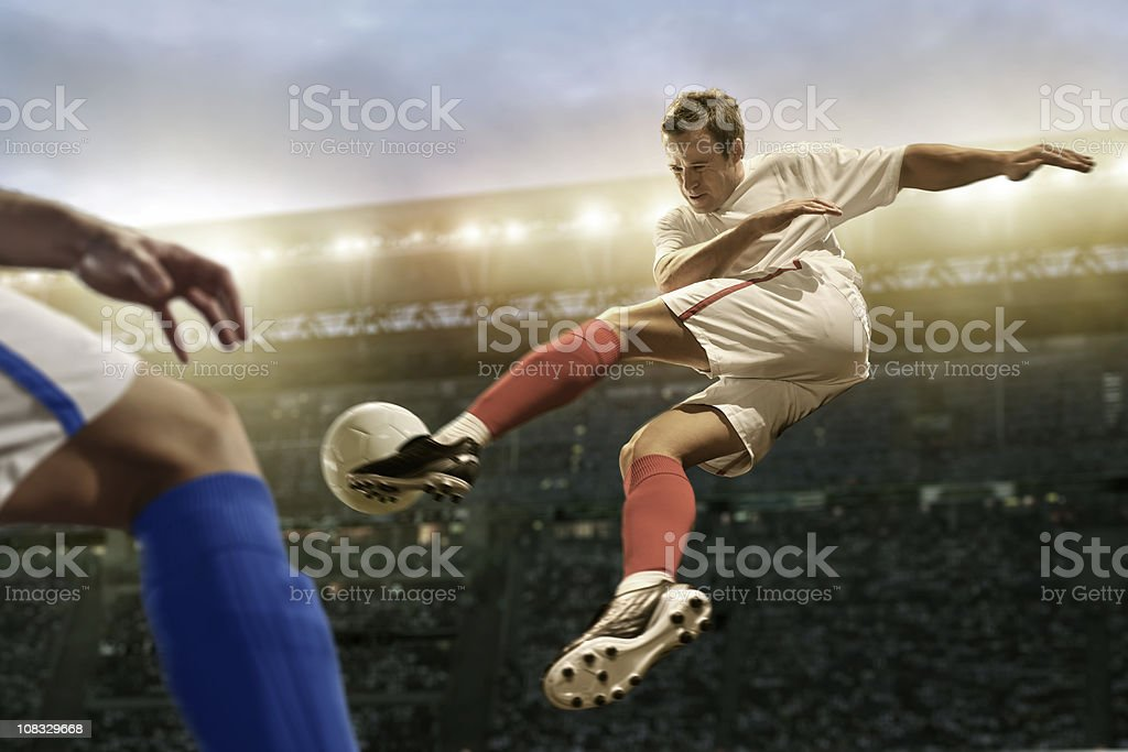 Soccer Player in Mid Air Kick stock photo
