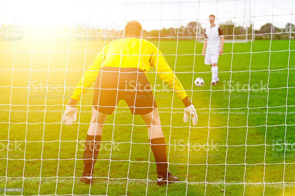 Soccer player is ready to kick ball from penalty spot stock photo