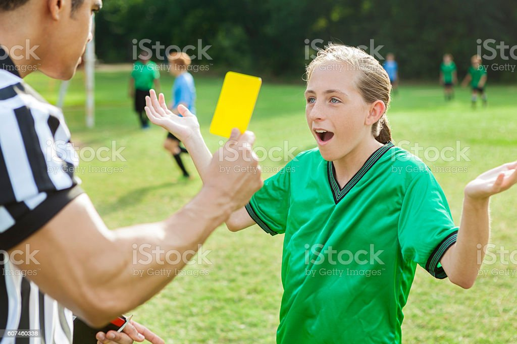 Soccer player is upset over referee's penalty call stock photo