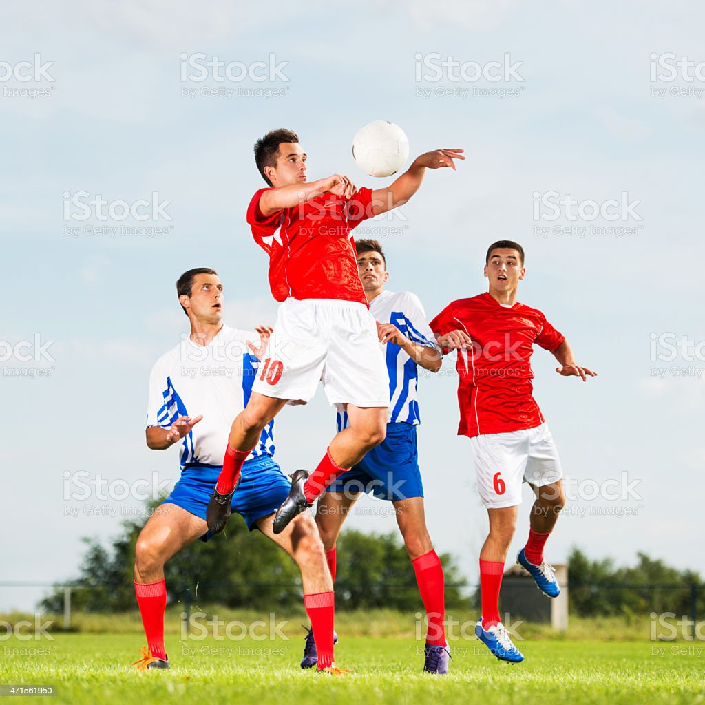 Soccer player jumping to head the ball. stock photo