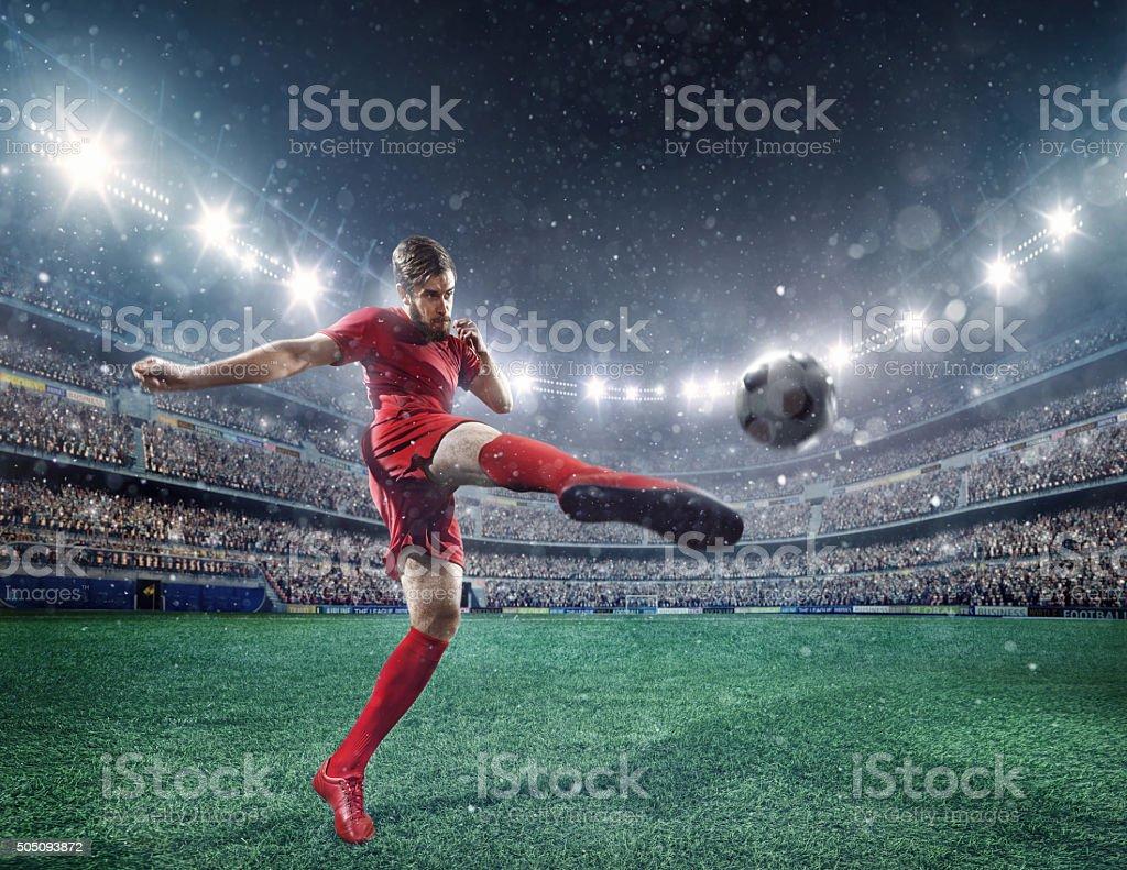 Soccer player kicking a ball stock photo
