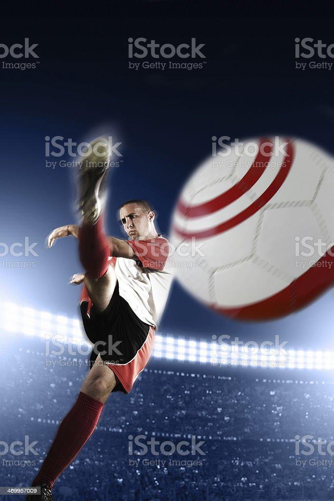 Soccer Player Kicking Ball stock photo