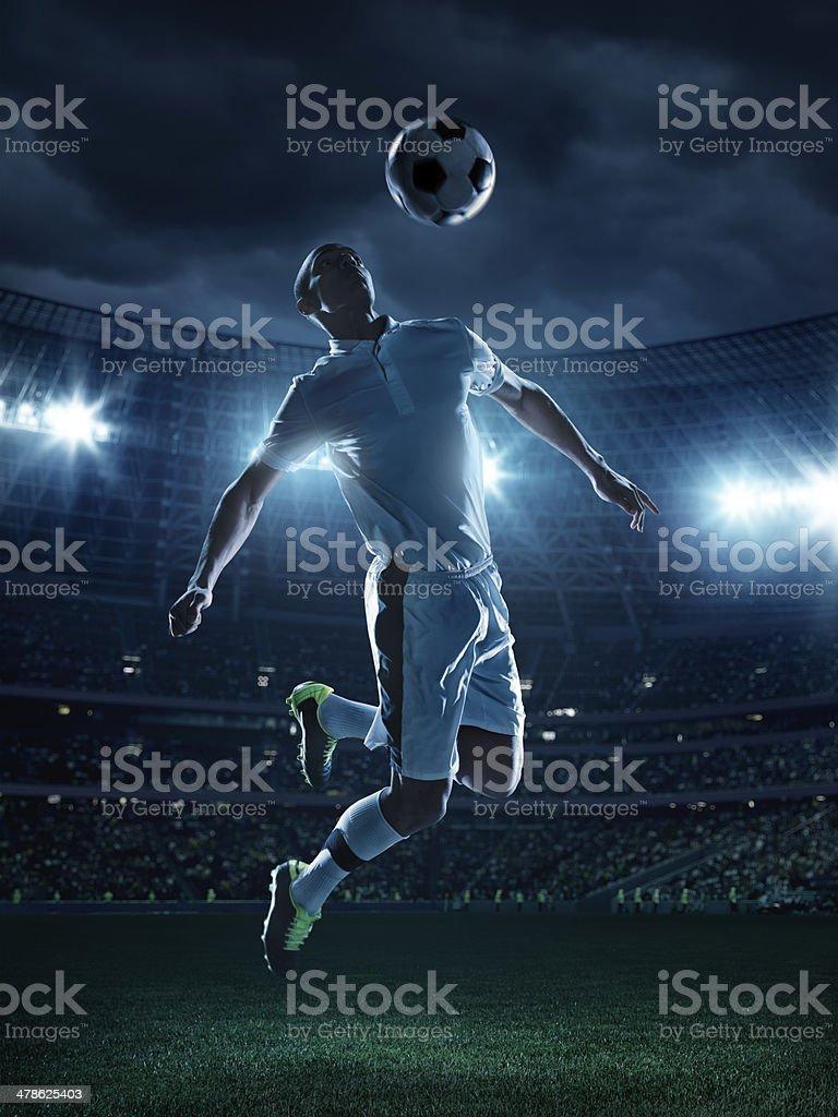 Soccer Player Kicking Ball royalty-free stock photo