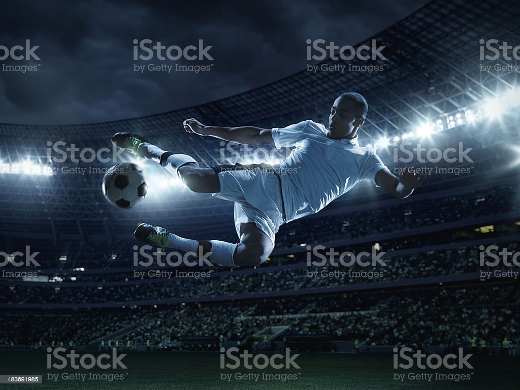 Soccer Player Kicking Ball stock photo