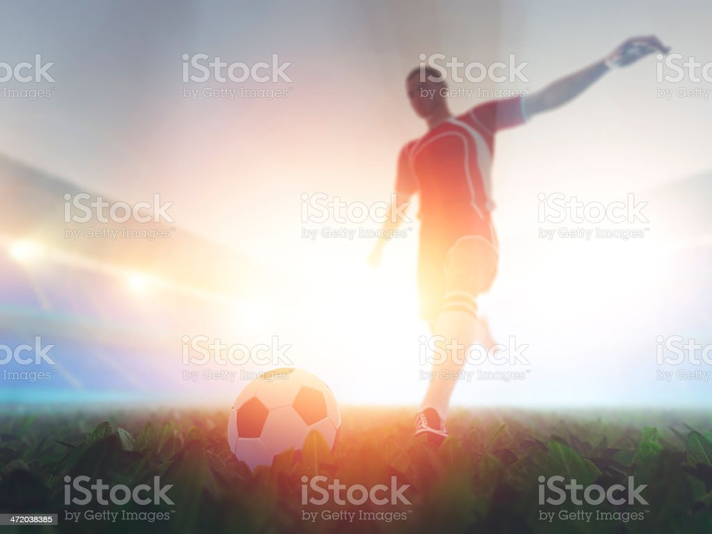 Soccer player kicking the ball stock photo