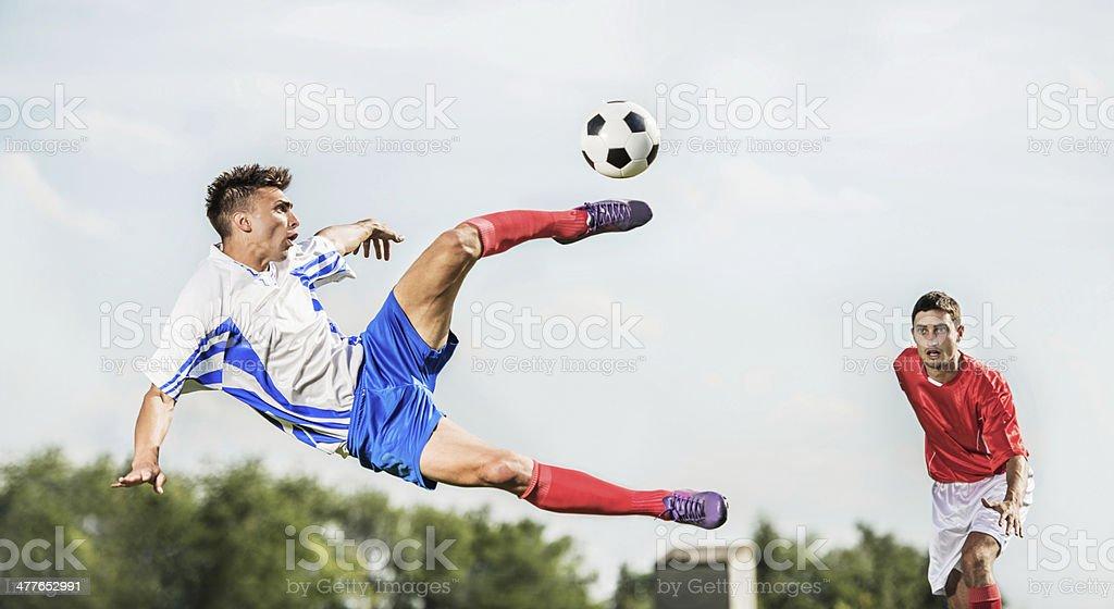 Soccer player kicking the ball. stock photo