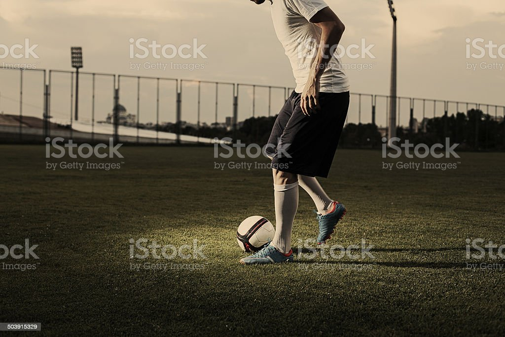 Soccer player makes tricks stock photo