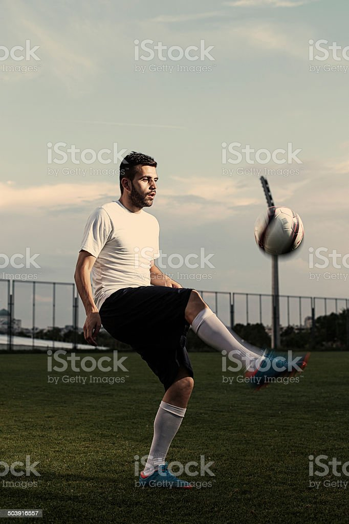 Soccer player makes tricks royalty-free stock photo