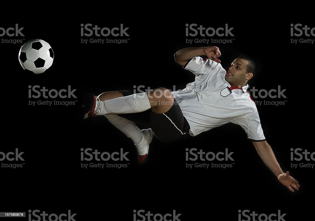 Soccer player mid air royalty-free stock photo