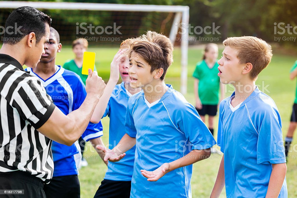 Soccer player objects to referees penalty call stock photo