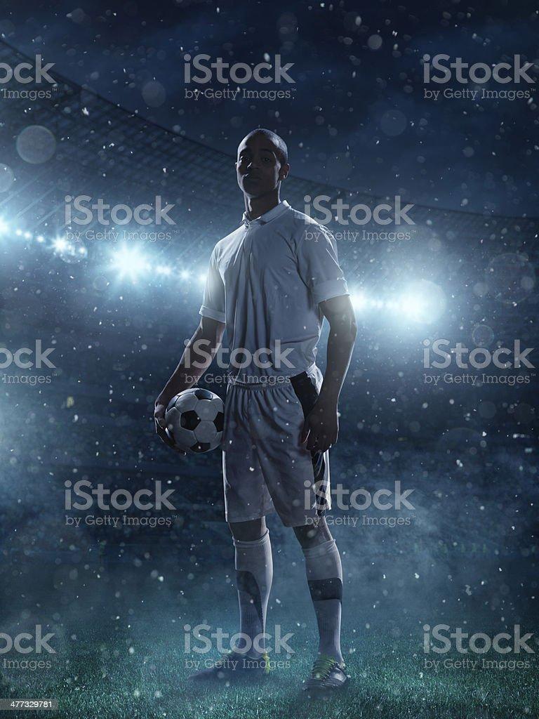 Soccer player on stadium stock photo