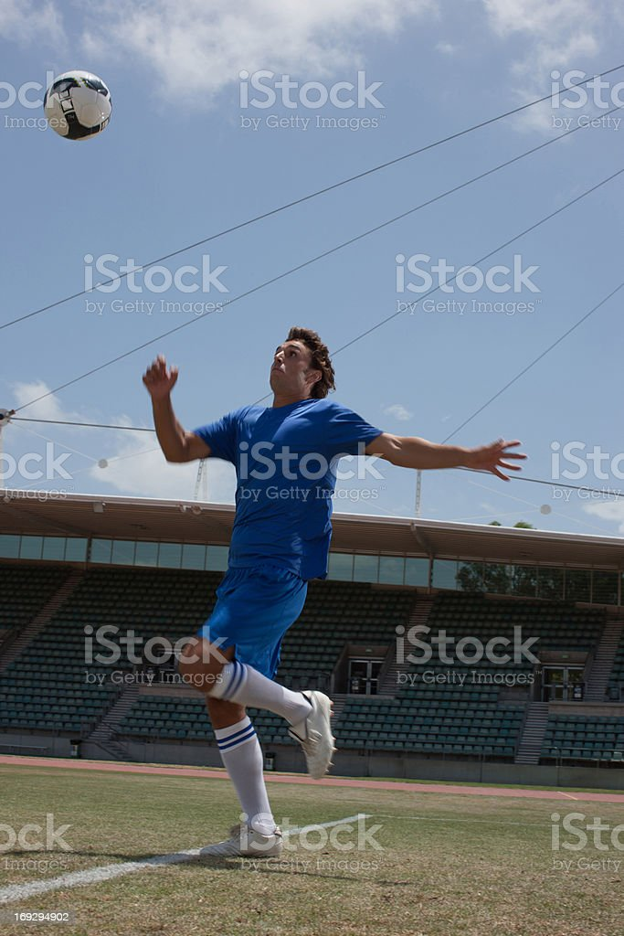 Soccer player playing soccer ball royalty-free stock photo