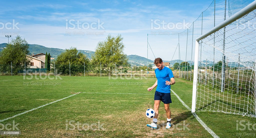Soccer player playing with ball stock photo