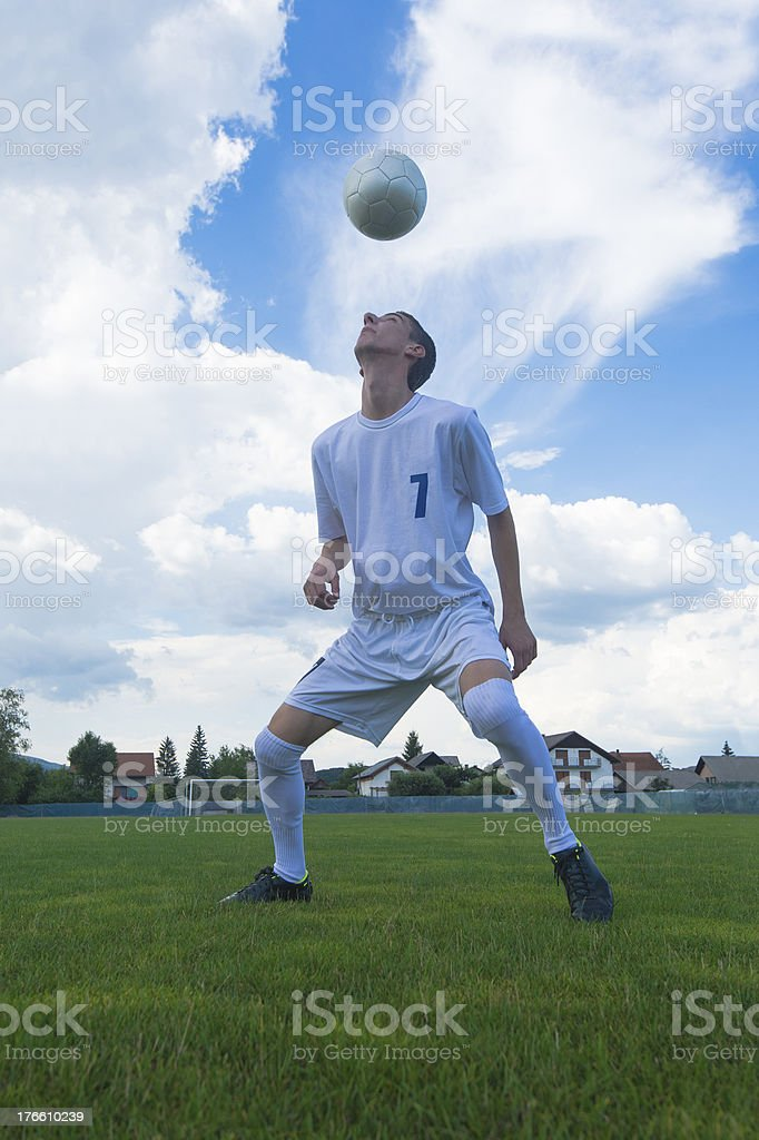 Soccer player practicing stock photo