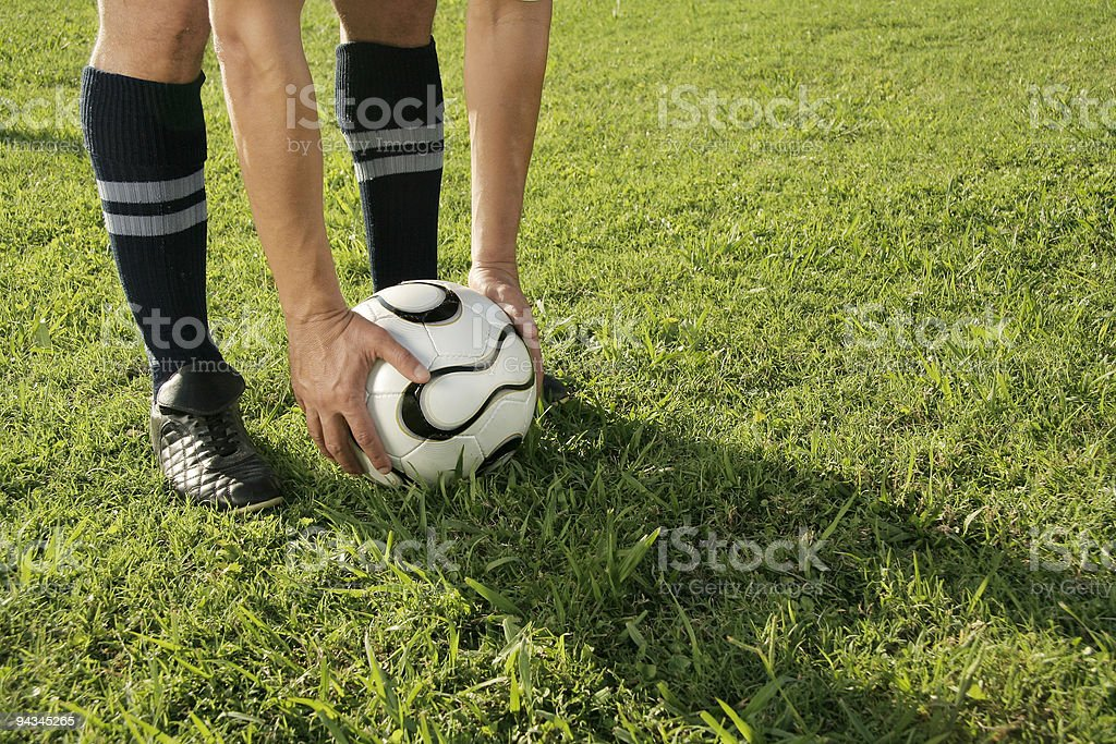Soccer player ready to kick stock photo