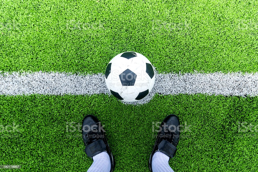 Soccer player ready to play at kick off point stock photo