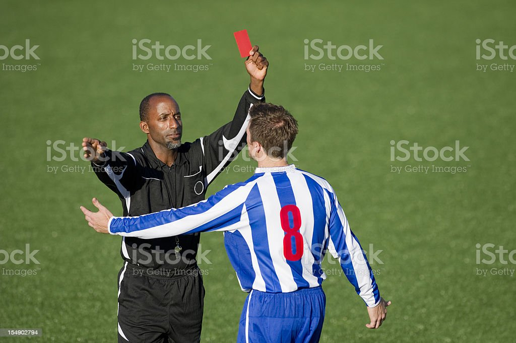 Soccer Player & Referee stock photo