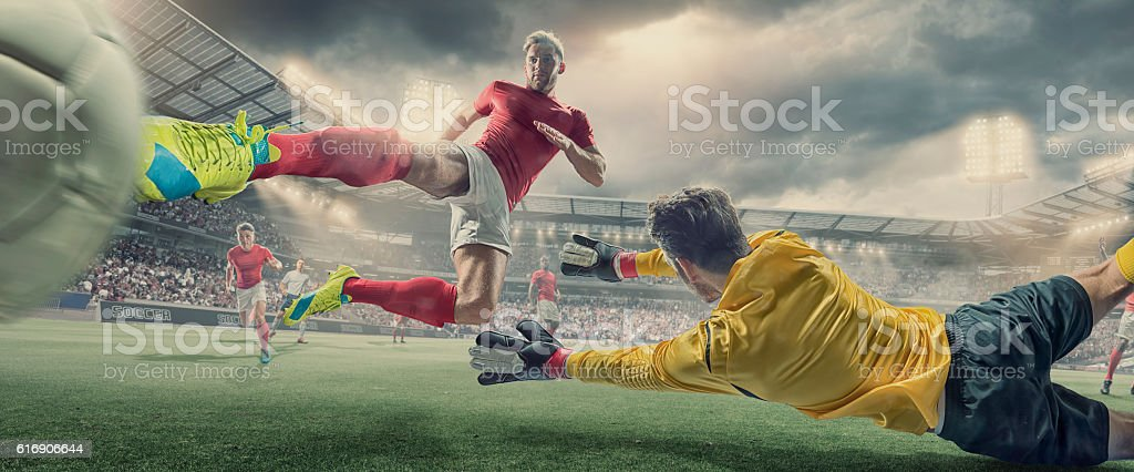 Soccer Player Scores Goal With Volley Kick In Football Match stock photo