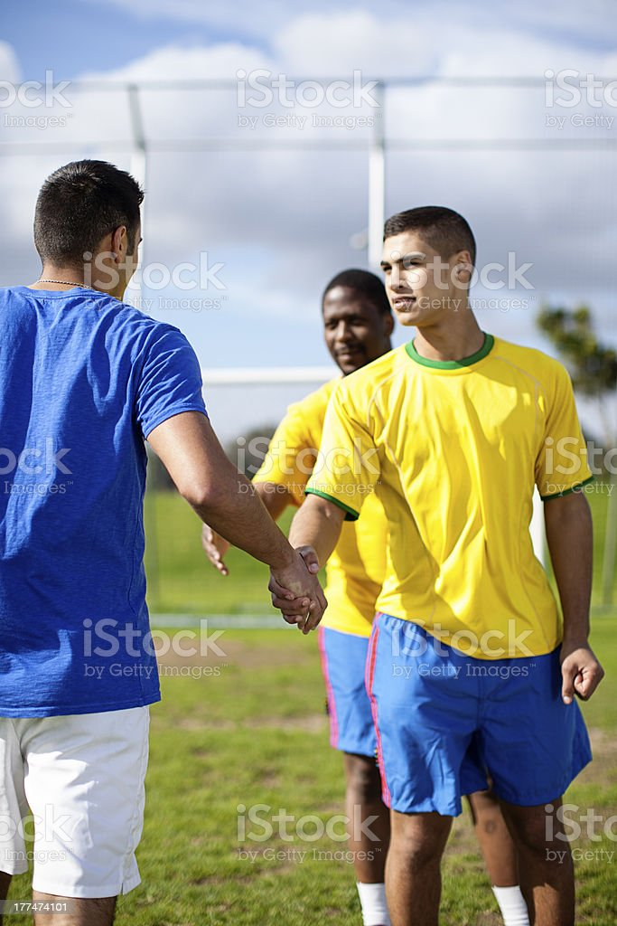 Soccer player shaking hands before match. royalty-free stock photo
