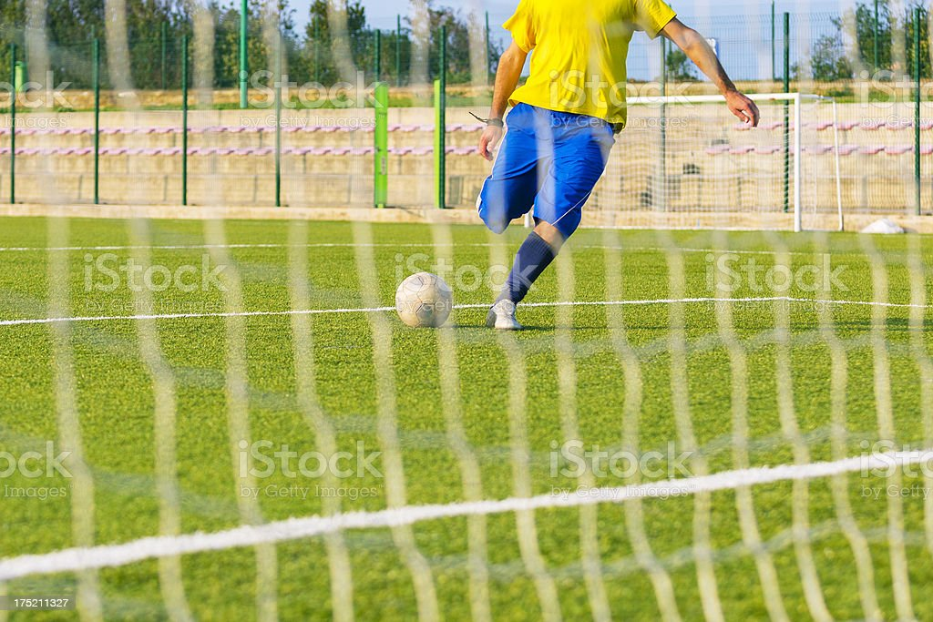 Soccer player shooting at goal royalty-free stock photo