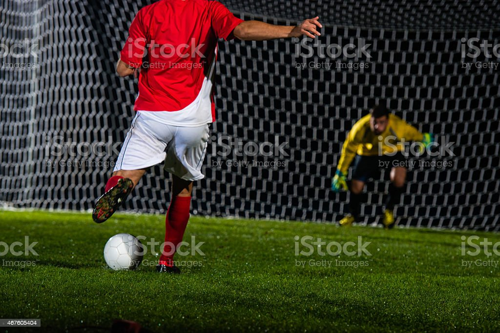 Soccer Player Shooting At Goal stock photo