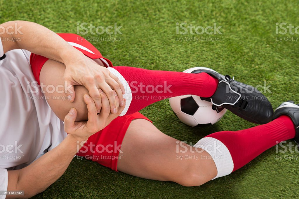Soccer Player Suffering From Knee Injury royalty-free stock photo