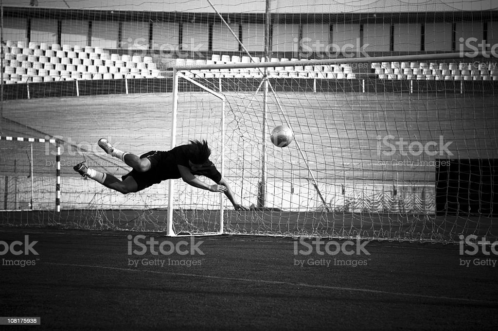 Soccer Player Using Head to Get Goal stock photo