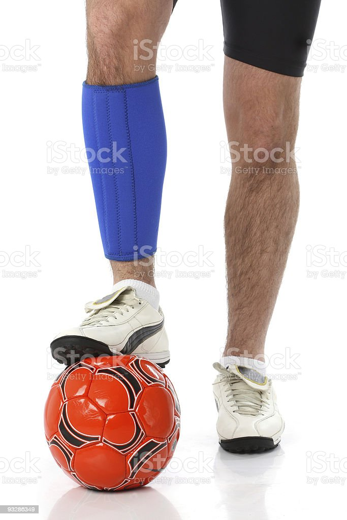 Soccer player wearing a neoprene brace royalty-free stock photo