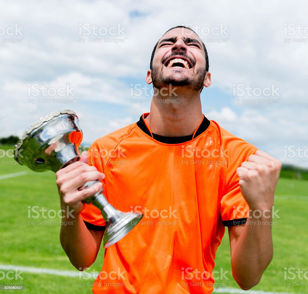 Soccer player with a cup stock photo