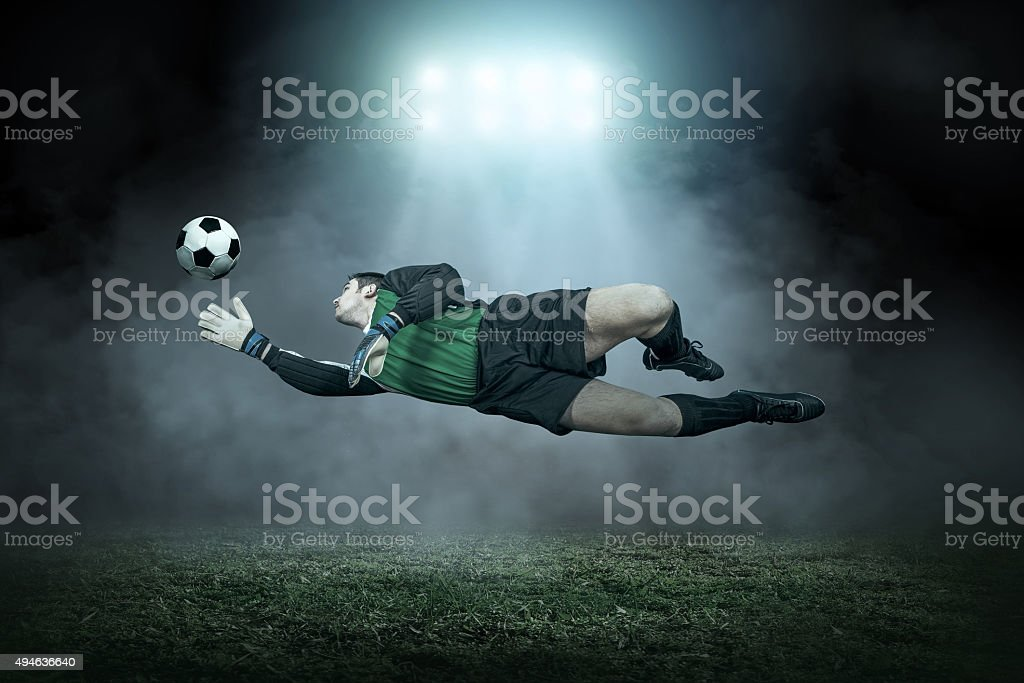 Soccer player with ball in action outdoors stock photo