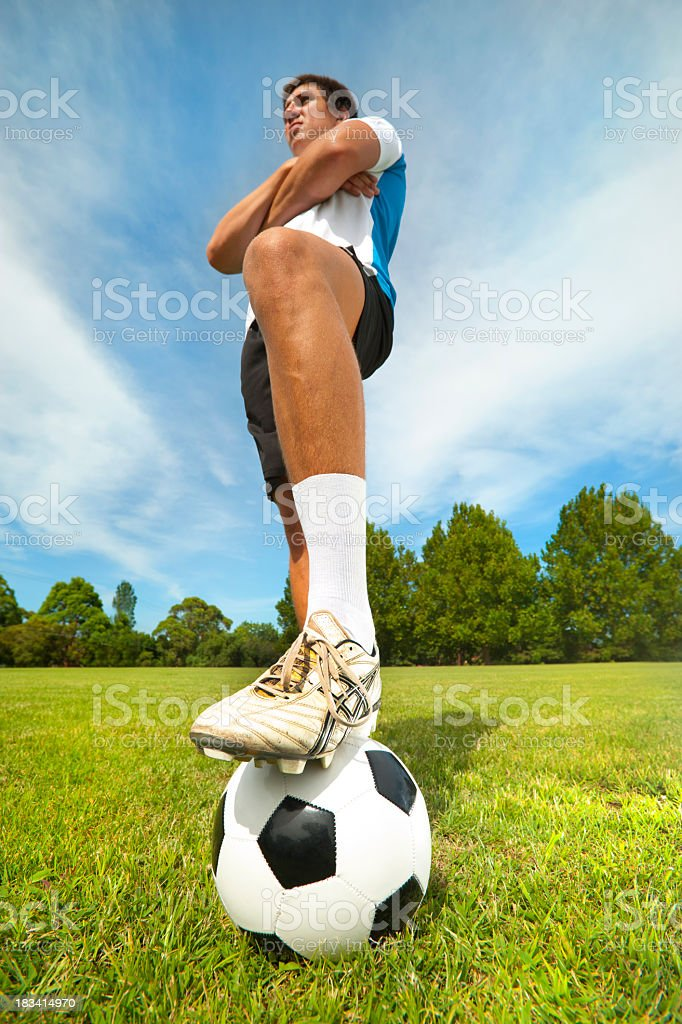 Soccer player with his foot on a ball royalty-free stock photo