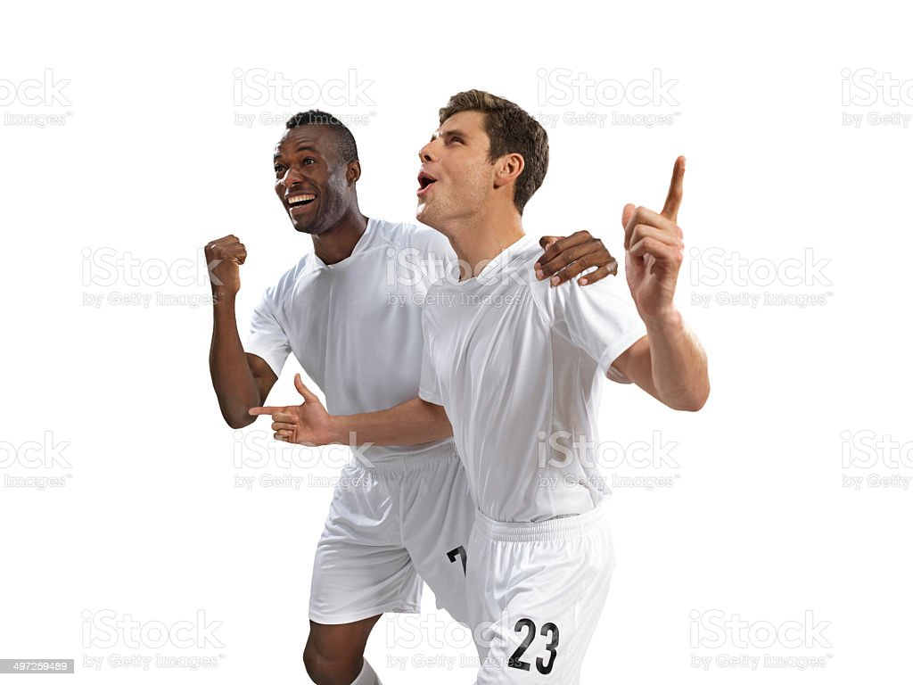 Soccer players are happy after scoring a goal royalty-free stock photo