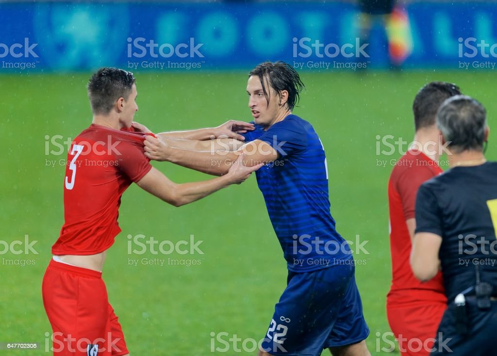 Soccer players arguing stock photo