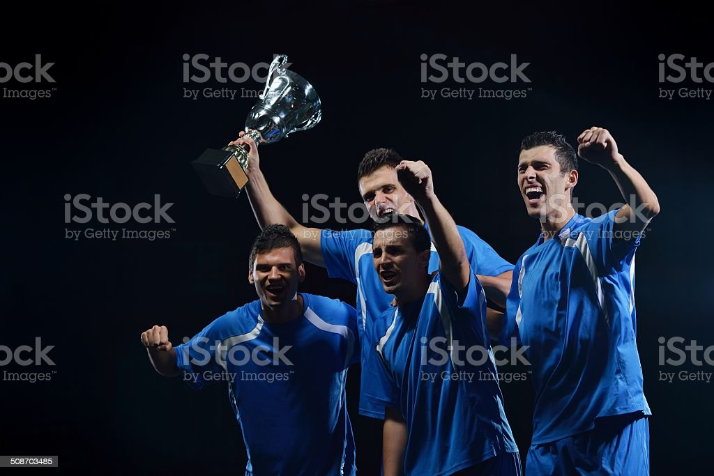soccer players celebrating victory stock photo