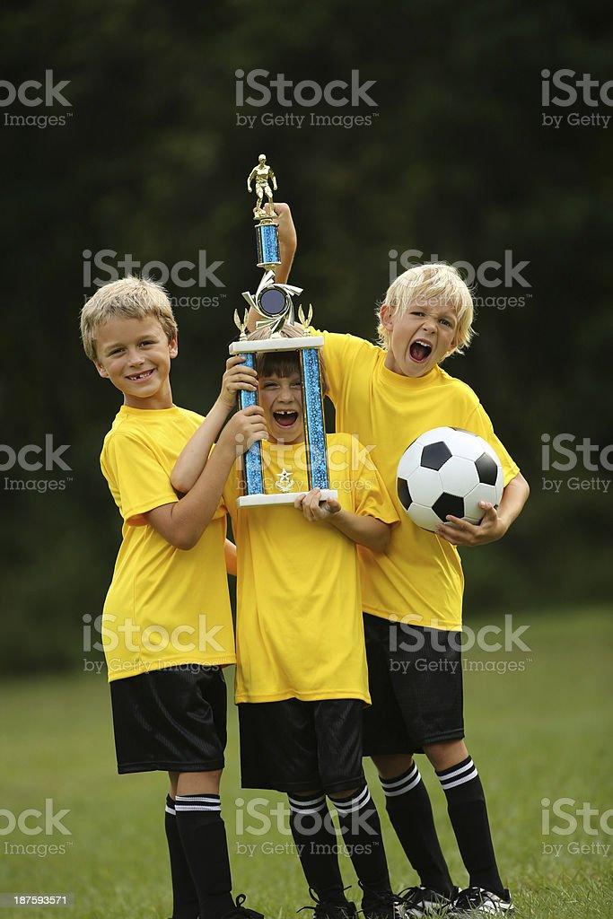 Soccer Players Cheering And Holding Victory Cup royalty-free stock photo