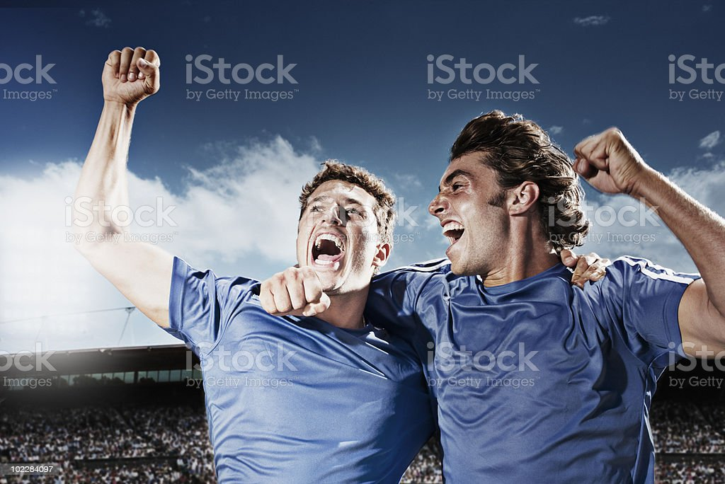 Soccer players cheering royalty-free stock photo