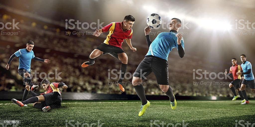 Soccer players fighting for ball in midair stock photo