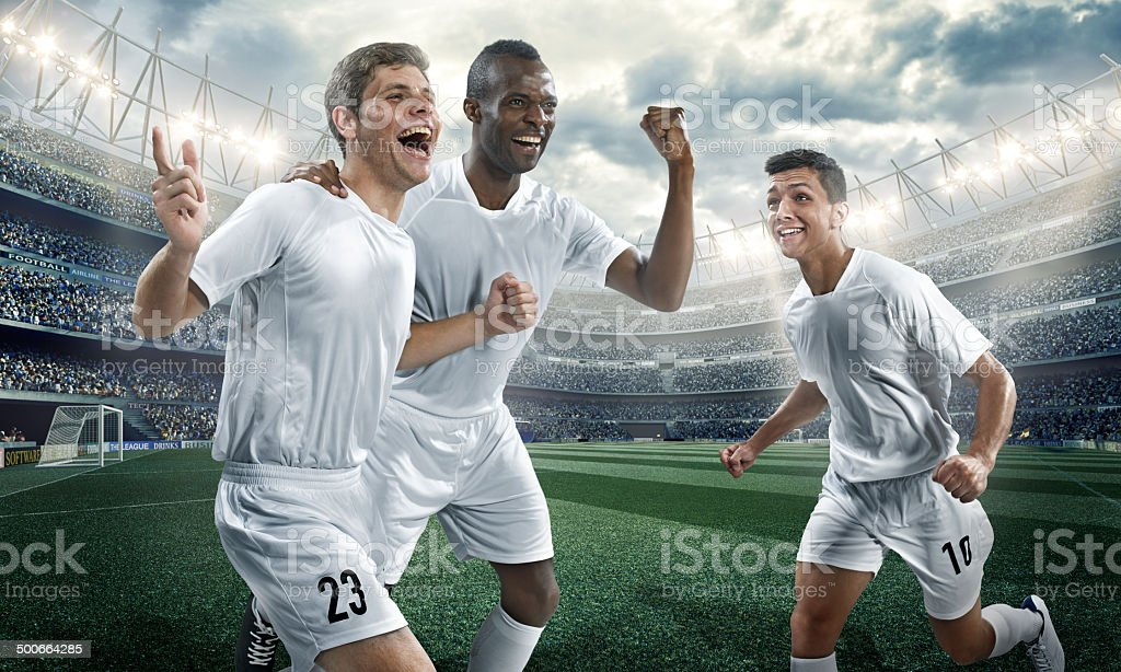 Soccer players happy scoring a goal royalty-free stock photo