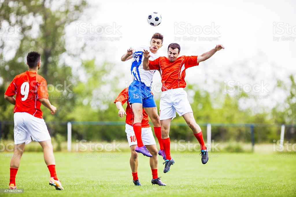 Soccer players heading the ball. stock photo