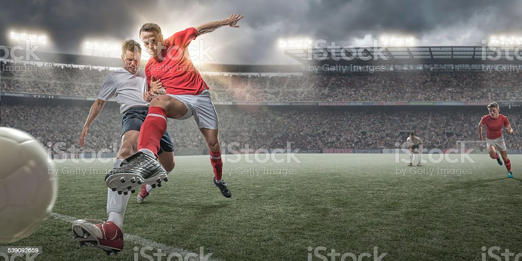 Soccer Players in Action stock photo