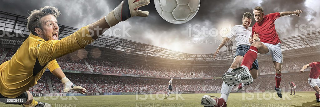 Soccer Players in Action Scoring Goal stock photo