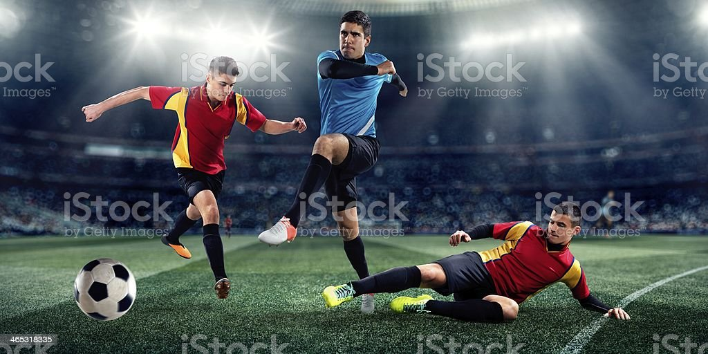Soccer players in stadium stock photo
